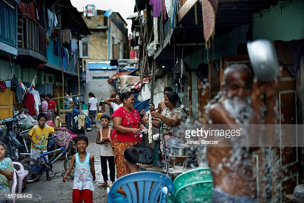 NEIGHBORHOOD MANDALAY MYANMAR Located in the city of Mandalay is a well guarded Muslim neighborhood residents have set up barbed wire around the...