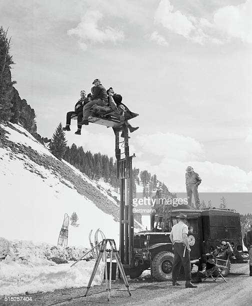 Location Shot Sun Valley Idaho Film star Cornel Wilde is up in the air about his new movie but it's not a temperament problem Wilde is up on a camera...