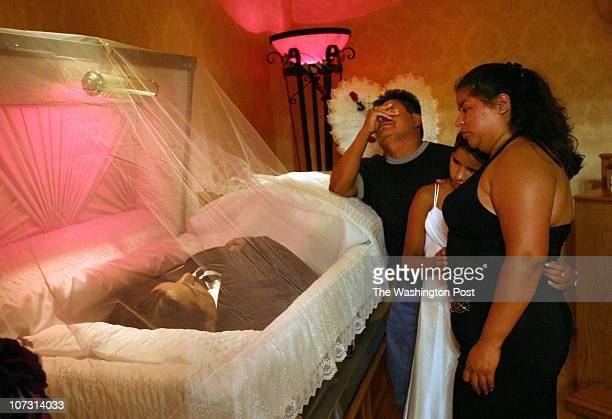 LOCATIONWashington DC PHOTOGRAPHERCarol Guzy CAPTION Geraldo Vasquez and his wife Carmen De Leon and daughter Brenda grieve at the viewing at Murray...