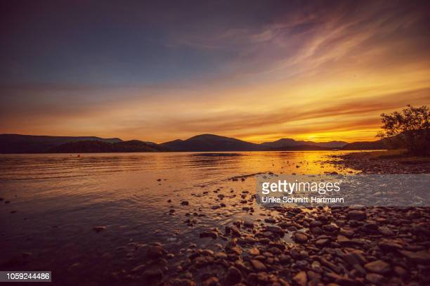 loch lomond at sunset - scotland stock pictures, royalty-free photos & images