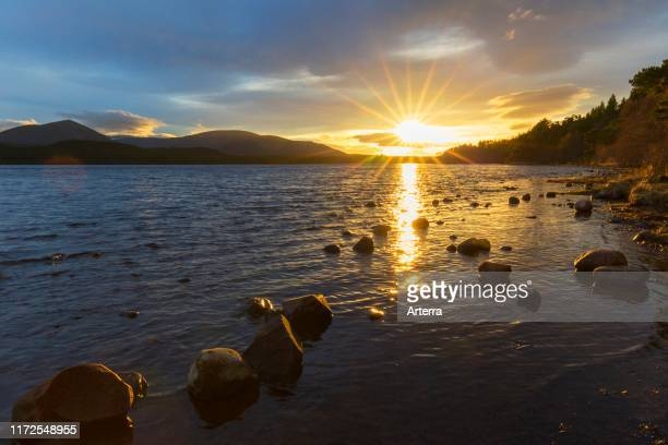 Loch Morlich and Cairngorm Mountains at sunset Cairngorms National Park near Aviemore Badenoch and Strathspey Scotland UK