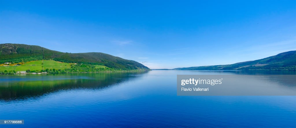 "Loch Ness, a large, deep, freshwater loch in the Scottish Highlands worldwide famous for its castle, Castle Urquhart, and for its monster, the shy ""Nessie"". : Stock Photo"