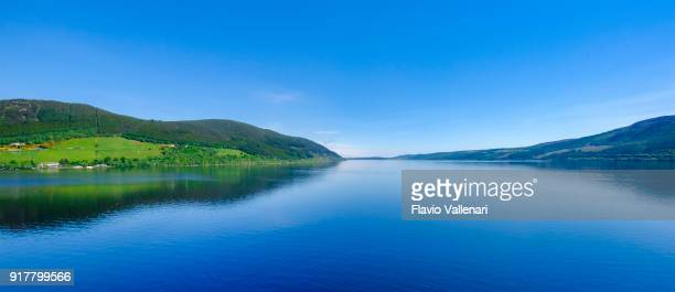 Loch Ness, a large, deep, freshwater loch in the Scottish Highlands worldwide famous for its castle, Castle Urquhart, and for its monster, the shy 'Nessie'.