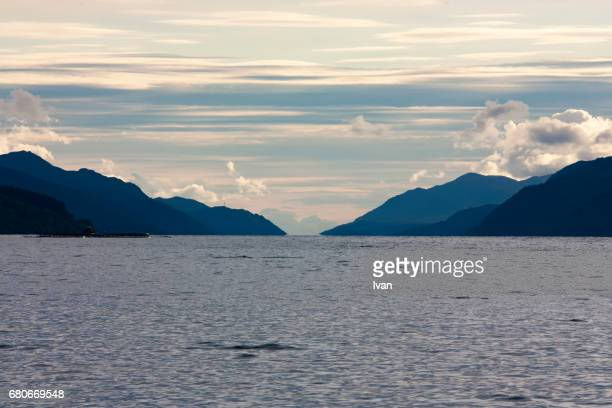 loch ness with dramatic sky and secret frog, scotland, uk - monster fictional character stock pictures, royalty-free photos & images
