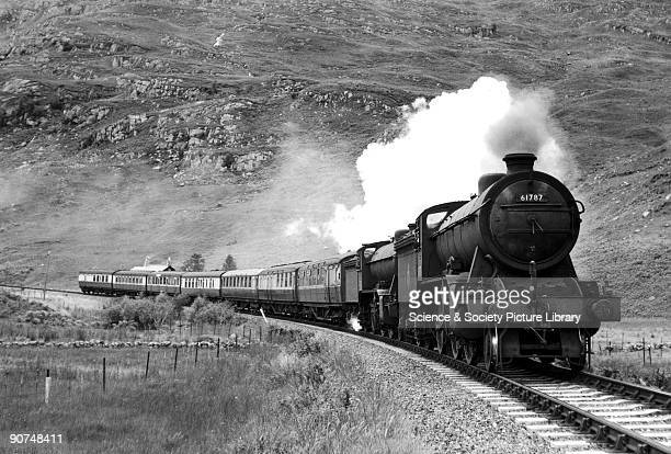 Loch Quoich' K2 Class steam locomotive No 61787 with passenger train on the West Highland line near Lochailort c 1950s Photograph by Bishop Eric...