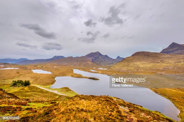 lochan an ais, one of the mountain lakes in the knockan crag national nature reserve, a globally important geological site located in the scottish highlands - nature reserve stock pictures, royalty-free photos & images