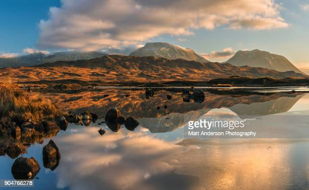 lochan na h-achlaise reflections panoramic #1 crop - scotland stock pictures, royalty-free photos & images