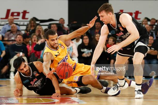 Lochlan Hutchinson of the Kings Shea Ili of United and Mitch McCarron of United contest the ball during game two of the NBL Semi Final Series between...