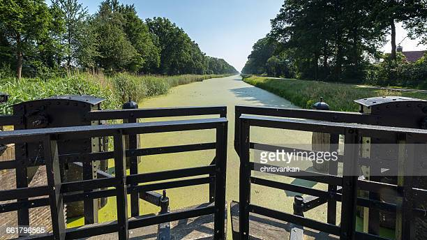 lock and canal, overijssel, twente, holland - overijssel stock pictures, royalty-free photos & images