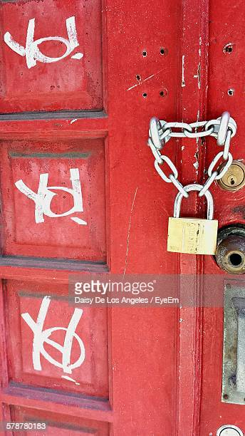 Lock And Chain On Red Door
