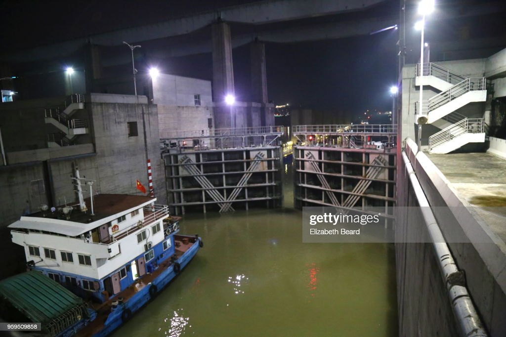 Lock gates closing behind a barge at Three Gorges Dam at night : Stock-Foto