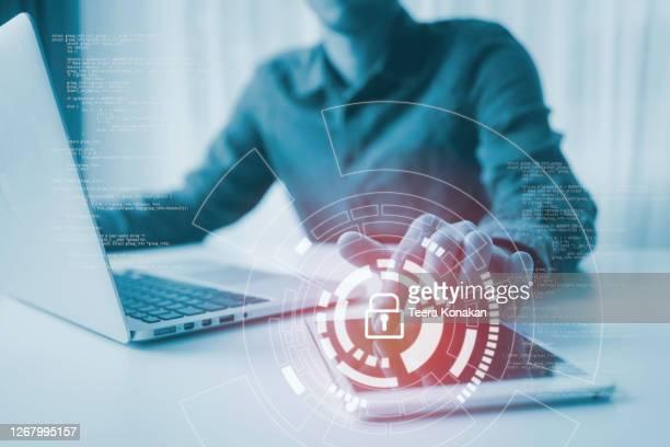 lock glowing icon pressed with finger, cyber security, information privacy - sicurezza di rete foto e immagini stock