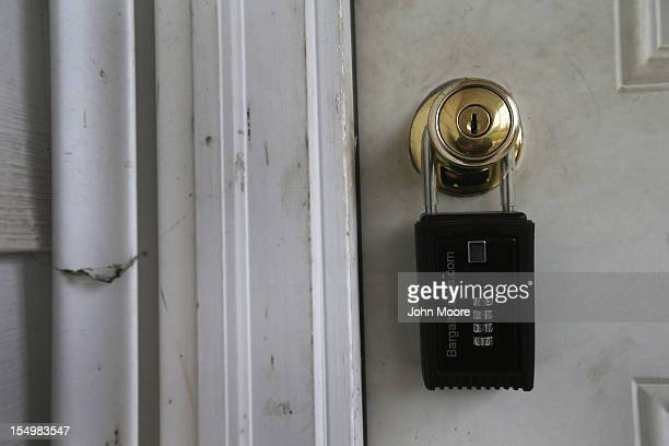 A lock hangs from the front door of a foreclosed house on October 29 2012 in Warren Ohio Political analysts have predicted Ohio voters could...