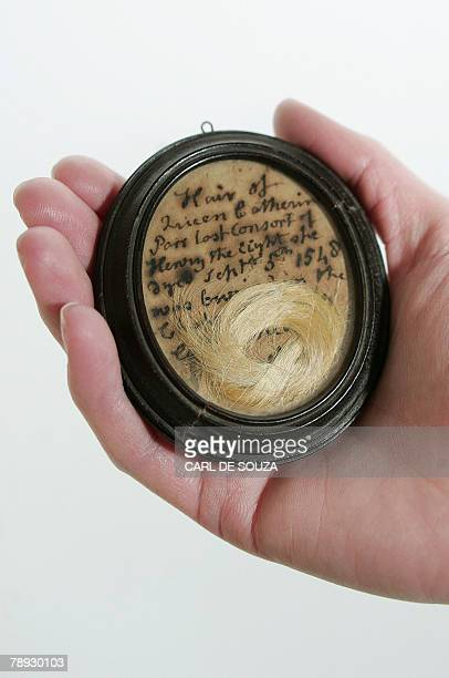 A lock of hair reputedly belonging to Catherine Parr the last of King Henry VIII's wives is displayed at Bonham's collection room in London 14...