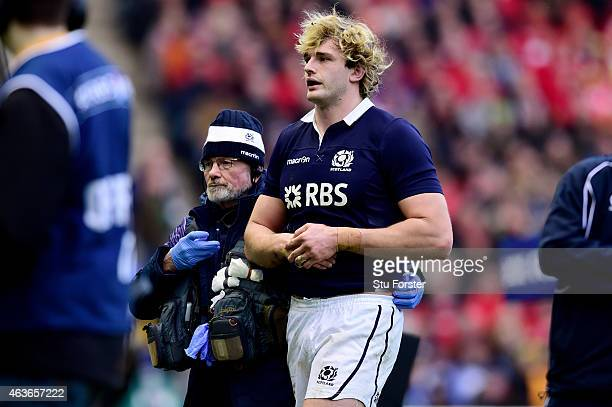Lock Richie Gray of Scotland leaves the pitch due to an arm injury during the RBS Six Nations match between Scotland and Wales at Murrayfield Stadium...
