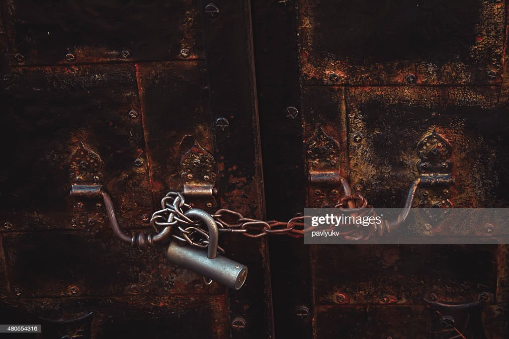 lock with a chain on the door : Stock Photo