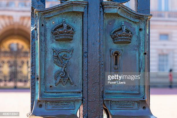 Lock with the royal crest on the gates at Buckingham Palace