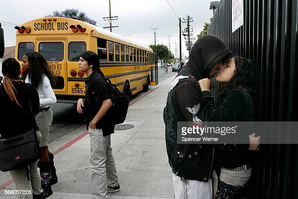 Locke High School students Cassandra Garcia with her boyfriend Salvador Picas meet up after school as a bus prepares to leave campus The bus routes...