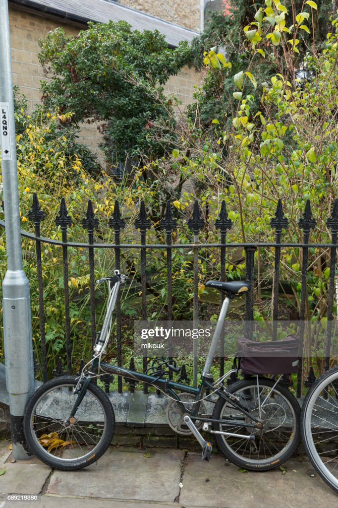 locked bicycle in the city centre of Cambridge England : Stock Photo
