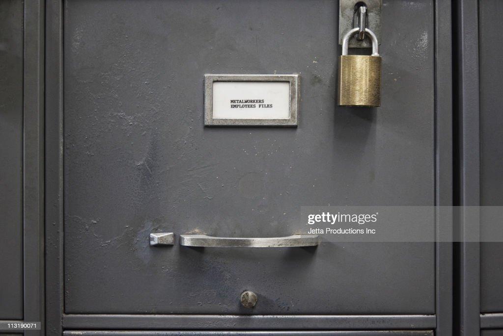 Locked file cabinet drawer : Stock Photo
