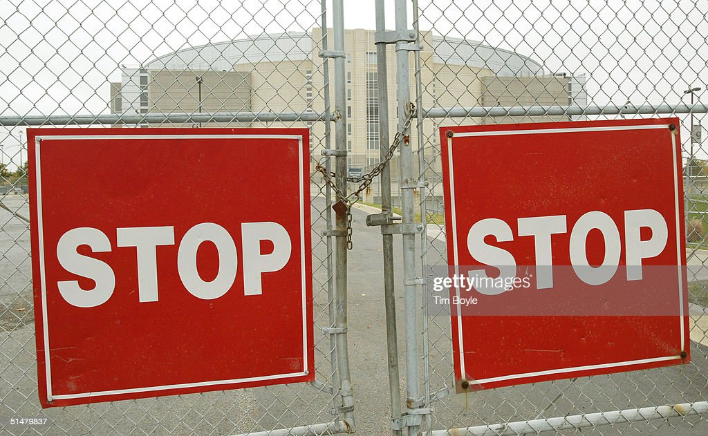 A locked gate between two large square Stop signs is seen at the United Center, home of the NHL Chicago Blackhawks hockey team October 14, 2004 in Chicago, Illinois. The National Hockey League season was to have opened last night but did not because of the near month-long lockout which started September 16.