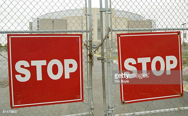 A locked gate between two large square Stop signs is seen at the United Center home of the NHL Chicago Blackhawks hockey team October 14 2004 in...