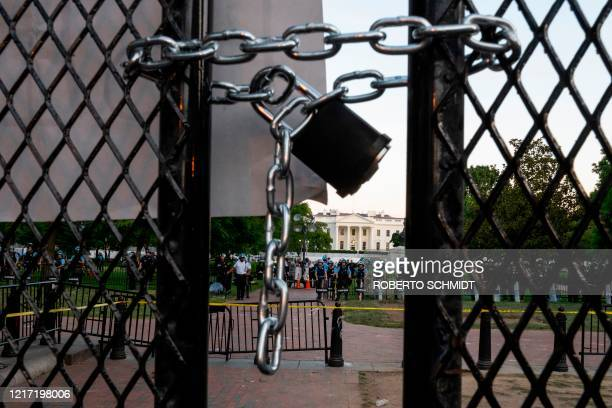 A locked padlock keeps a metal fence recently erected in front of the White House and meant to keep protestors at bay closed on June 2 2020...
