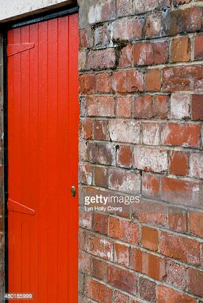 locked red door and red brick wall - lyn holly coorg stock pictures, royalty-free photos & images