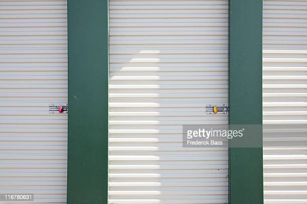 locked storage units at a self storage facility - self storage stock pictures, royalty-free photos & images