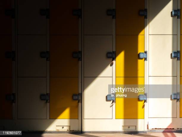 locker in the sunshine with an half in dark - korea stock pictures, royalty-free photos & images