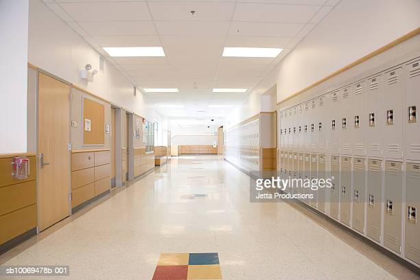 lockers in empty high school corridor - education stock pictures, royalty-free photos & images