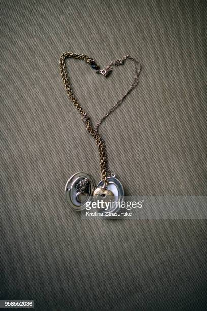 a locket pendant and a heart pendant - pendant stock pictures, royalty-free photos & images
