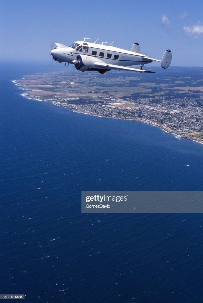 Lockheed 10 Electra Flying Over Coast : Stock Photo