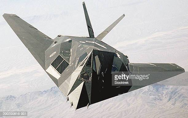lockheed f-117a nighthawk stealth fighter in flight over desert - stealth bomber stock photos and pictures