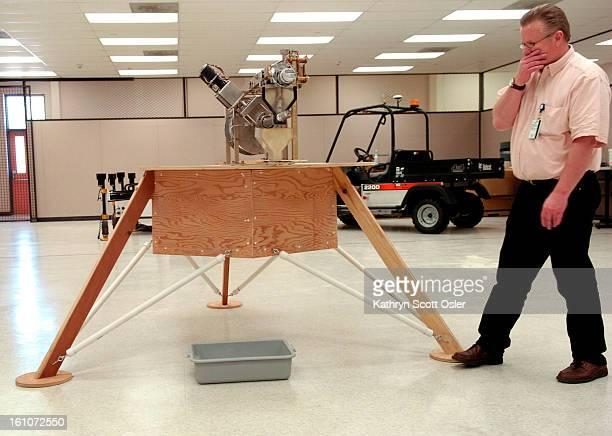 Lockheed Martin Astronautics tests robots against lunar sand. Larry Clark,<cq> Senior Manager Spacecraft Technology Development Lab-KATY HUMAN WILL...
