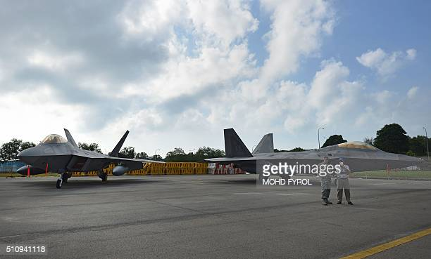 Lockheed Martin F22 Raptors from the US Air Force sit on display at the Singapore Airshow in Singapore on February 18 2016 Asia's largest aerospace...