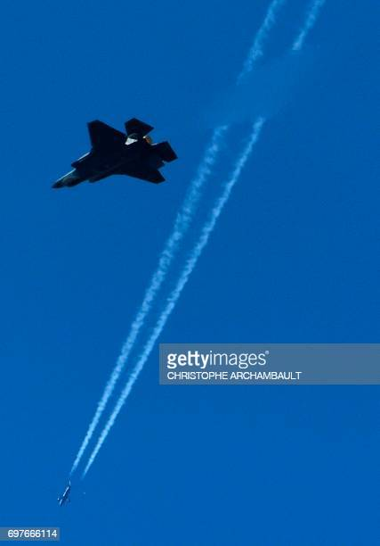 Lockheed Martin F-35 fighter jet performs during a flight display at the International Paris Air Show in Le Bourget outside Paris on June 19, 2017. /...