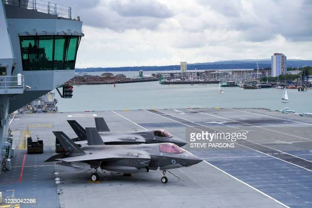 Lockheed Martin F-35B Lightning combat aircraft are pictured on the flight deck of the aircraft carrier HMS Queen Elizabeth in Portsmouth, southern...