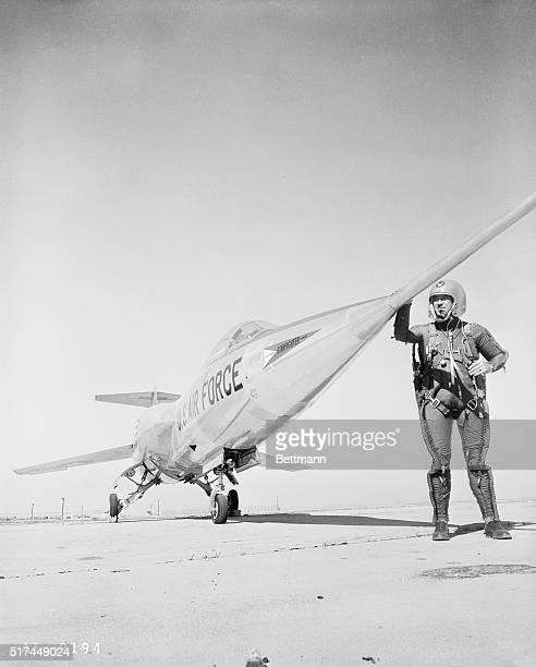 Lockheed's chief engineering test pilot Herman R. Salmon stands next to the new Lockheed F-104A J-79 turbojet, producing higher thrust per pound of...