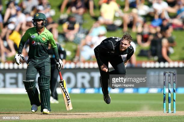 Lockie Ferguson of New Zealand bowls while Shadab Khan of Pakistan looks on during game five of the One Day International Series between New Zealand...