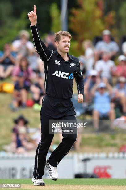 Lockie Ferguson of New Zealand celebrates after dismissing Babar Azam of Pakistan during the second match in the One Day International series between...
