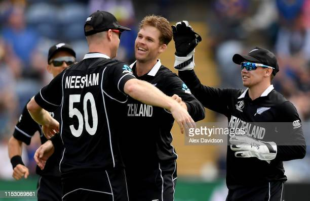 Lockie Ferguson of New Zealand celebrates taking the wicket of Jeevan Mendis of Sri Lanka with his teammates during the Group Stage match of the ICC...