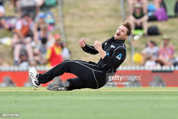 Lockie Ferguson of New Zealand fields the ball off his own bowling during the second match in the One Day International series between New Zealand...