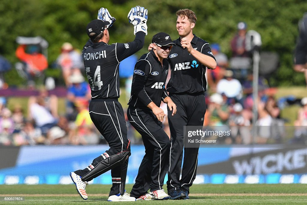 Lockie Ferguson of New Zealand (R) is congratulated by team mates after dismissing Shakib Al Hasan of Bangladesh during the first One Day International match between New Zealand and Bangladesh at Hagley Oval on December 26, 2016 in Christchurch, New Zealand.