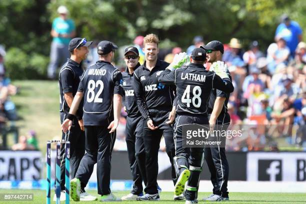 Lockie Ferguson of New Zealand is congratulated by team mates after dismissing Jason Mohammed of the West Indies during the One Day International...