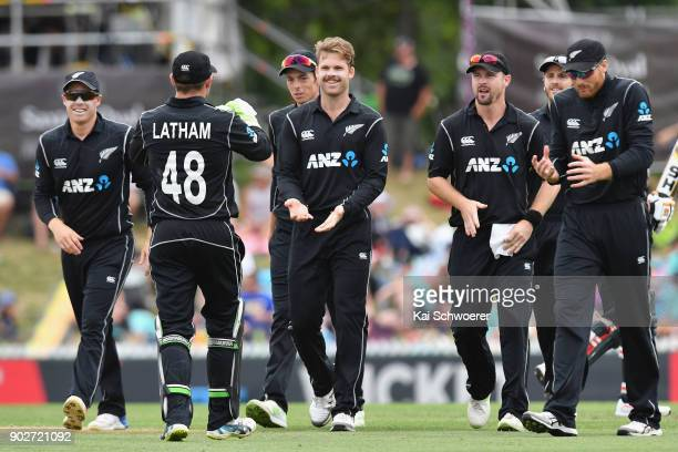 Lockie Ferguson of New Zealand is congratulated by team mates after dismissing Babar Azam of Pakistan during the second match in the One Day...