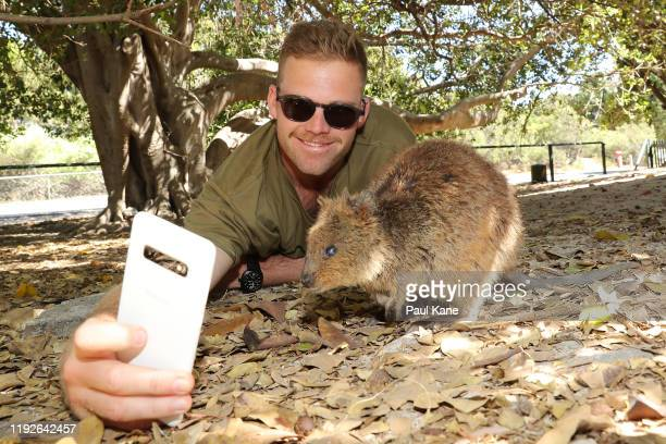 Lockie Ferguson of the New Zealand Test team takes a selfie with a Quokka during a visit to Rottnest Island on December 08, 2019 in Perth, Australia.