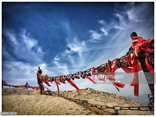 Locks And Red Ribbons On Chain At Mount Hua Against Sky