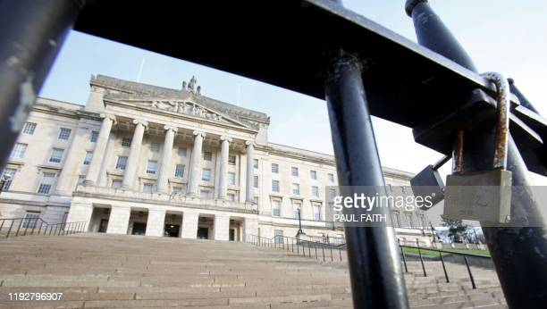 Locks are pictures on the closed gates outside Parliament Buildings, on the Stormont Estate, in Belfast on January 10, 2020. - A draft deal to revive...
