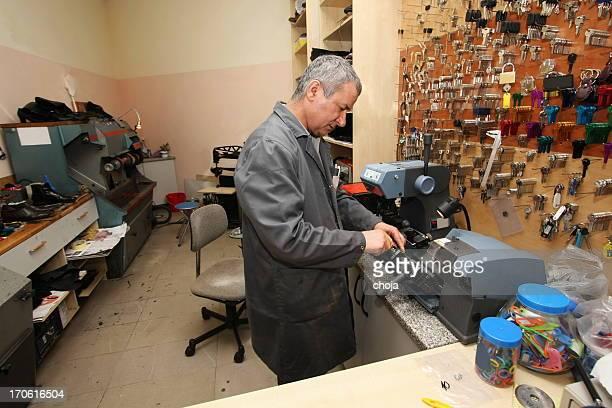 locksmith at work....making spare key - locksmith stockfoto's en -beelden